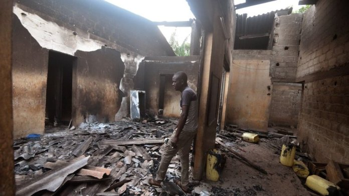 A man cries inside his destroyed house in Toumodi, central Ivory Coast, on November 3, 2020.