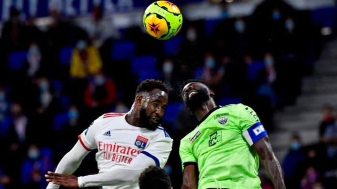 Lyon's French forward Moussa Dembele (L) and Dijon's Gabonese defender Bruno Ecuele Manga (R) jump to head the ball during the French L1 footall match between Olympique Lyonnais (OL) and Dijon FC on August 28, 2020, at the Groupama Stadium in Decines-Charpieu, near Lyon, central-eastern France.