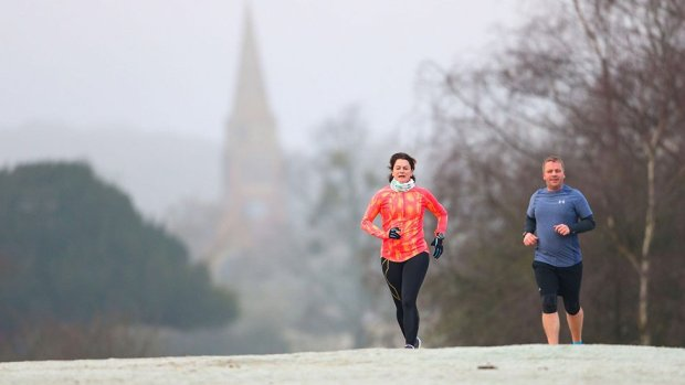 Runners on a cold and frosty morning near Lyndhurst in the New Forest