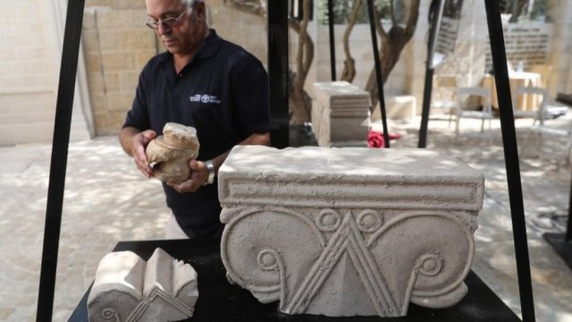 A stone capital, from a palace from the era of a Biblical Jewish kingdom in Jerusalem, is presented by the Israel Antiquities Authority (3 September 2020)