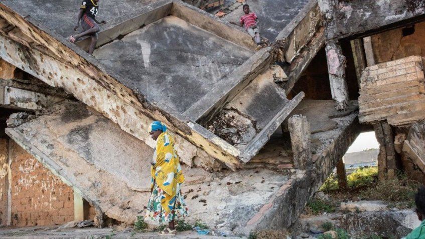 Children play in a derelict building damaged during the civil war in Angola, Kuito - 2019