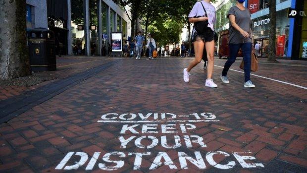 A Covid-19 social distancing public notice on a street in Birmingham