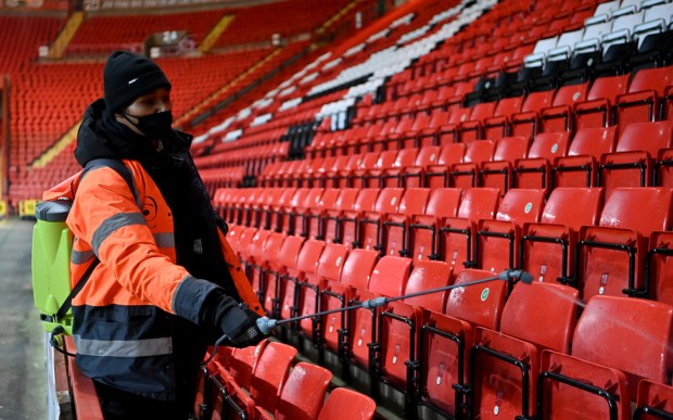 Stadium staff disinfect seats, following the Charlton Athletic v Milton Keynes Don match at The Valley