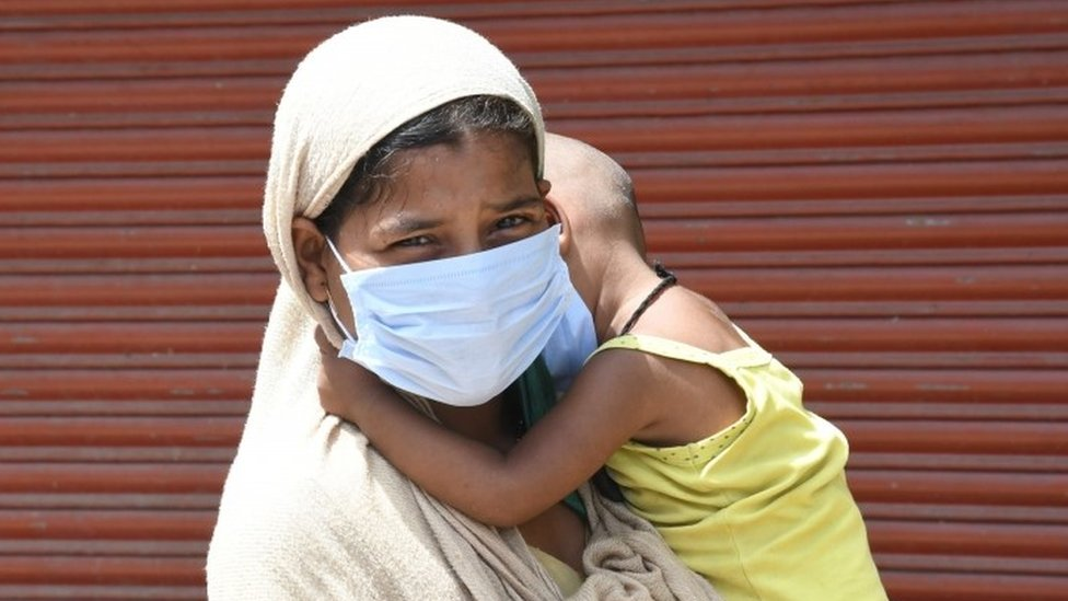 Woman and son wait for testing in Delhi, India. File photo