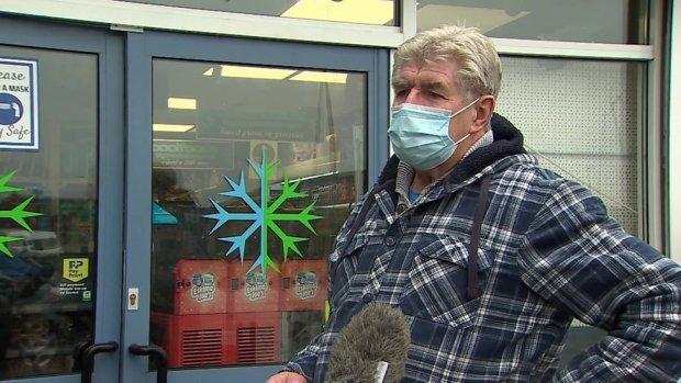 Shopper in mask in Merthyr