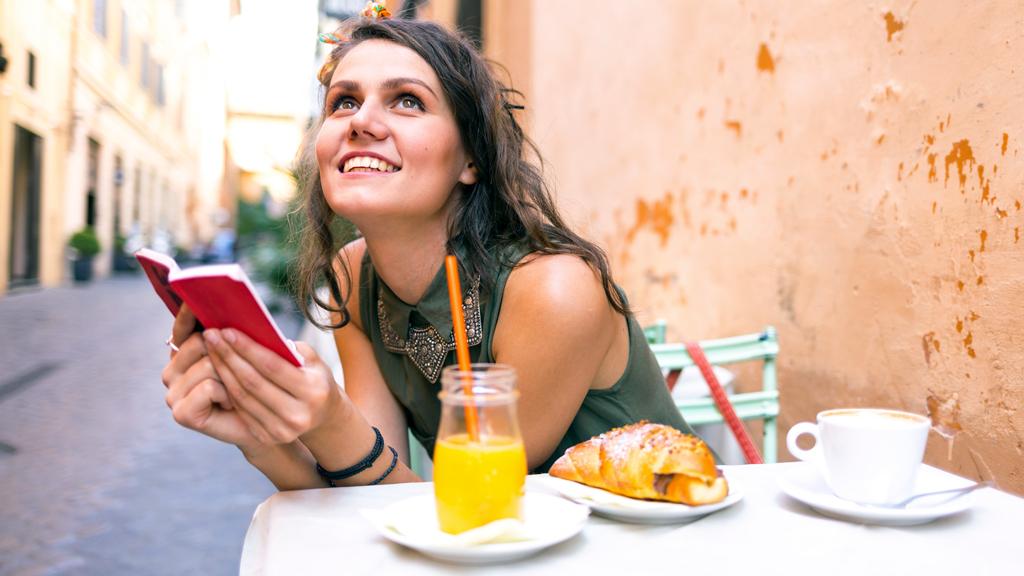 Woman at Italian street cafe