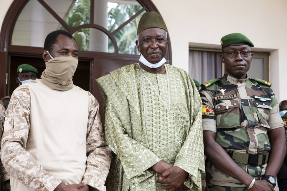 Mali junta leader and new transition vice president Colonel Assimi Goita (L) with the new transition president former defence minister Bah Ndaw (C) and Colonel Malick Diaw (R) of the National Committee for the Salvation of the People (CNSP) pose for a photograph during a meeting with Economic Community Of West Africa (ECOWAS) in Bamako, Mali, 24 September 2020. The 70-year-old Bah Ndaw who had been retired was appointed transition president by a committee chosen by the junta.