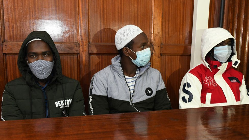 Hussein Hassann Mustafah, Liban Abdullah Omar, and Mohamed Ahmed who are charged with aiding the gunmen involved in the Westgate Mall attack of September 2013, sit in the dock during their appearance for their case at the Milimani court in Nairobi on October 5, 2020.
