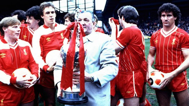 Bob Paisley poses with the winning First Division League Championship trophy in his last season in charge of the club with his players, including Sammy Lee (far L) Phil Neal and Craig Johnson (far R) after the First Division match between Liverpool and Aston Villa held on May 7, 1983 at Anfield