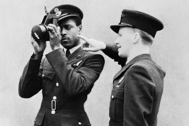 Johnny Smythe being instructed in the use of the sextant by a flying officer instructor