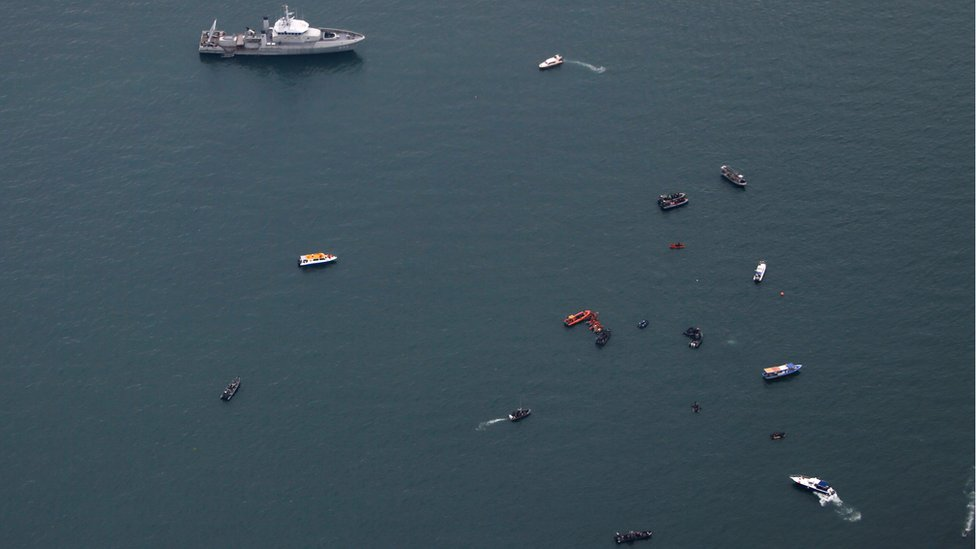 Ships pictured during a search for the Sriwijaya Air flight SJ-182 near Jakarta, Indonesia