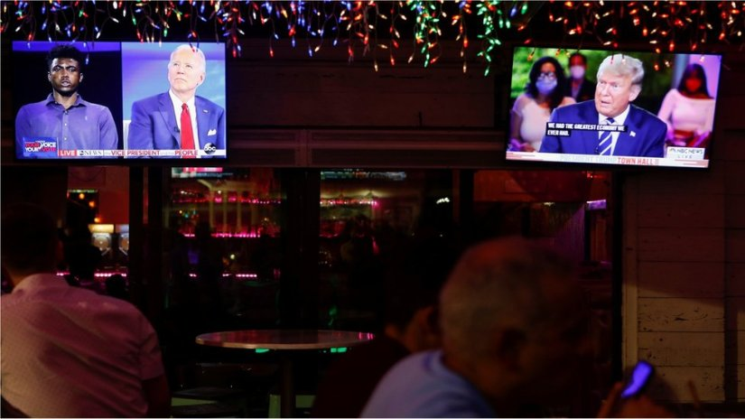 People watch the dual town halls of Democratic presidential candidate Joe Biden and President Donald Trump at a restaurant in Florida