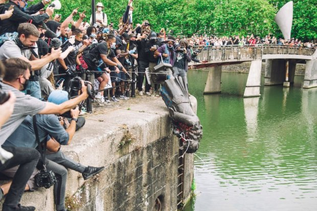 The statue of Colston is pushed into the River Avon. Edward Colston was a slave trader of the late 17th century who played a major role in the development of the city of Bristol, England, on 7 June 2020.