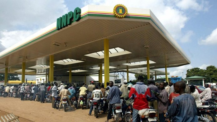 Motorcyclists wey queue for fuel inside goment filling station for Abuja