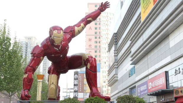 A sculpture of Iron Man, a fictional superhero from Marvel Comics, outside a shopping mall in Zhengzhou in central China's Henan province