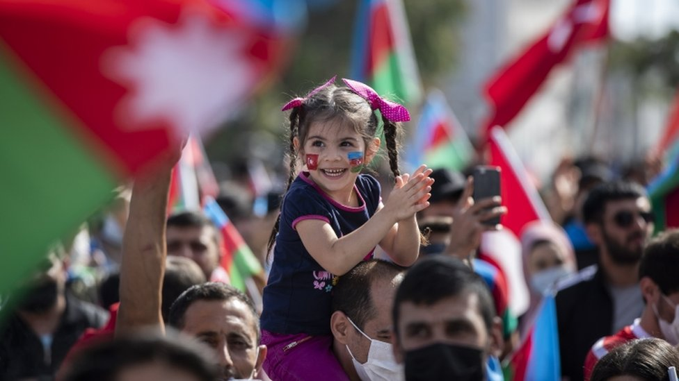 Protesters hold Azerbaijan and Turkish flags as they shout slogans in a demonstration for supporting Azerbaijan against Armenia in Istanbul