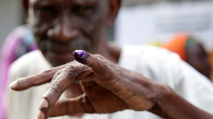 Voter displays his inked finger after casting a ballot during the presidential and parliamentary elections at the Ukombozi primary school in Dar es Salaam, Tanzania October 28, 2020.