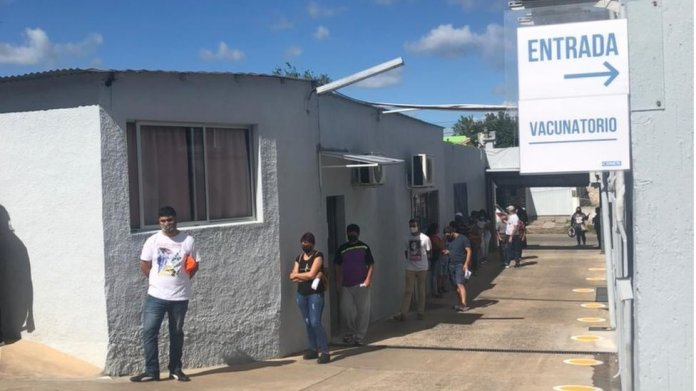 People wait in line to be vaccinated