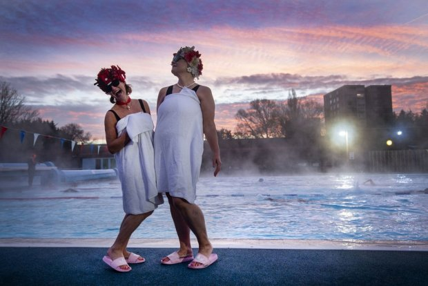 Jessica Walker and Nicola Foster posing by the pool during sunrise before swimming at Charlton Lido in Hornfair Park, London, on its first day of reopening after the second national lockdown ended.