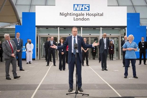 Matt Hancock stands in front of NHS Nightingale Hospital
