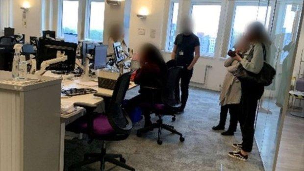 Staff gathered around a desk