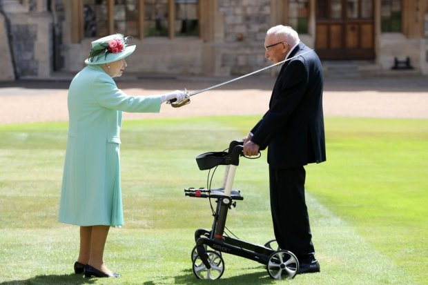 The Queen uses a sword to knight Captain Tom Moore