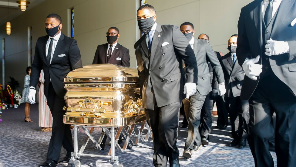 trump Pallbearers bring the coffin into the church
