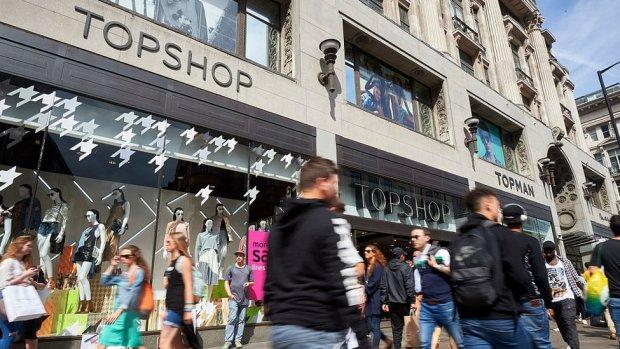 People walk past Topshop, Oxford Street