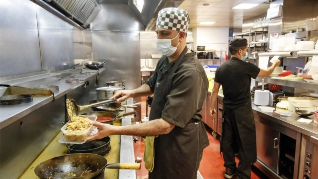Food being prepared by a Chef in the kitchen at the Mumtaz restaurant in Leeds. They will be handing out free food boxes during half term for any child who would normally get a free school lunch after MPs voted to reject a motion to provide food to those in need during the school holidays.