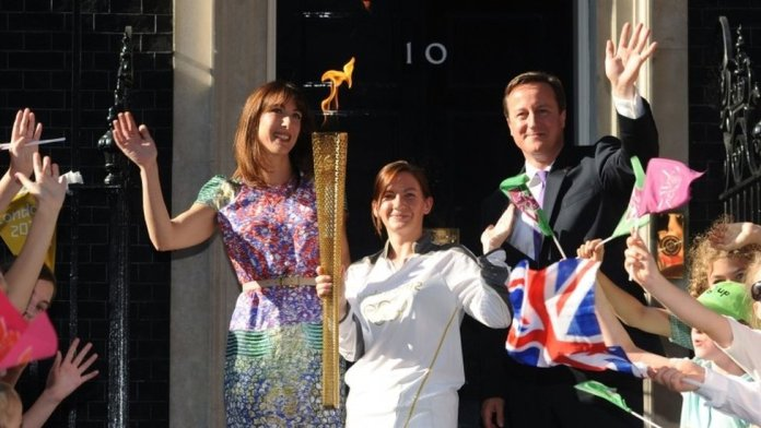 David and Samantha Cameron welcome the Olympic Torch carried by Kate Nesbitt