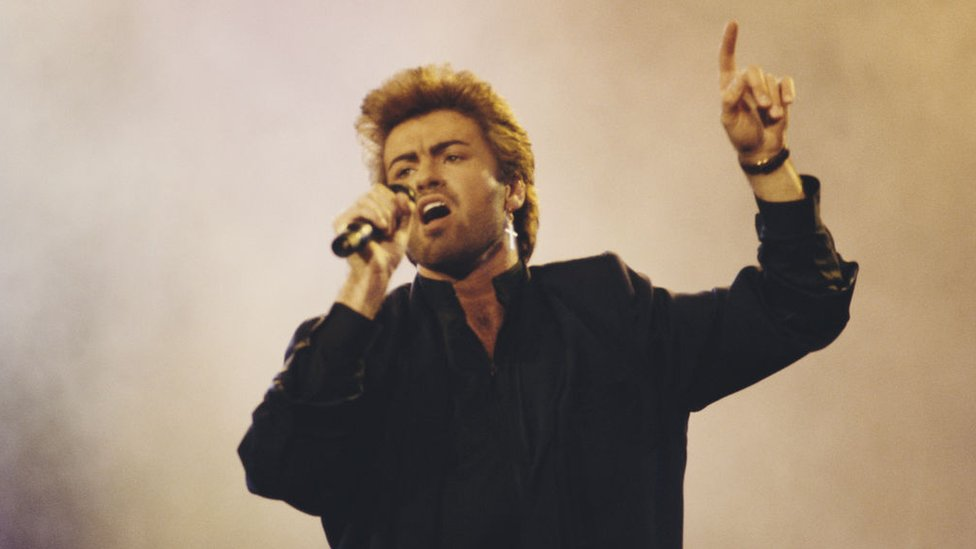 George Michael performs live on stage at an Aids awareness charity concert at Wembley Arena in London in April 1987