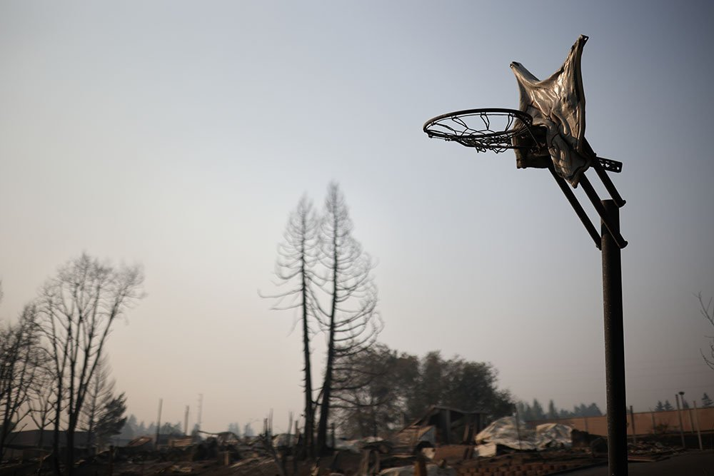A melted basketball backboard is seen after wildfires destroyed a neighbourhood in Bear Creek, Phoenix, Oregon