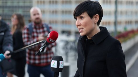 Norway's Foreign Minister Ine Marie Eriksen Soreide talks to the media outside the Ministry of Foreign Affairs on 13 October