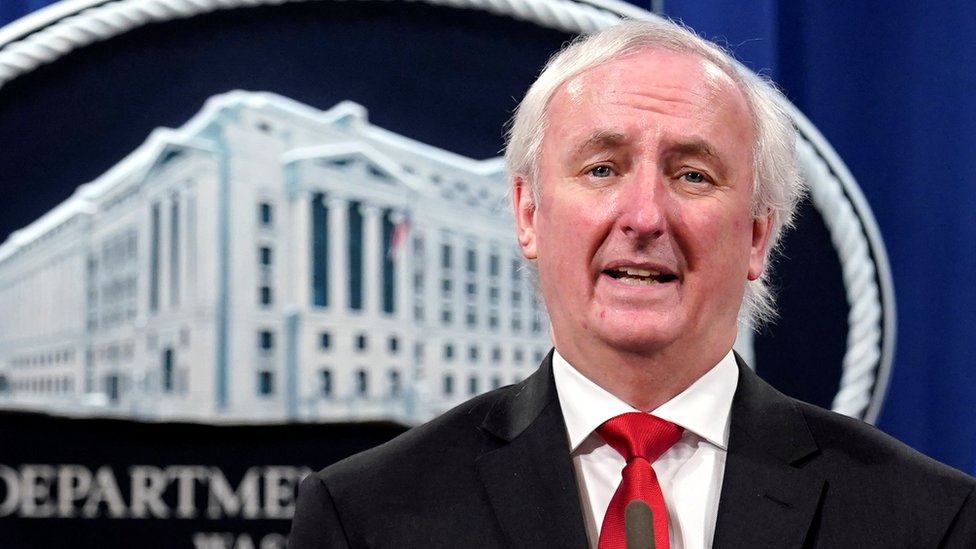 Deputy Attorney General Jeffrey Rosen in front of a Department of Justice backdrop