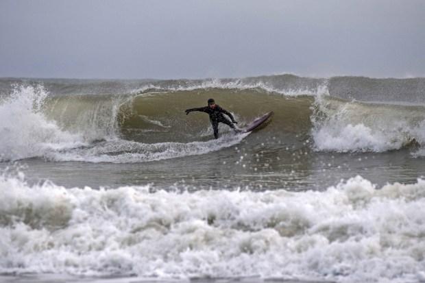 Surfers at Langland Bay, near Swansea, 14 January 2021