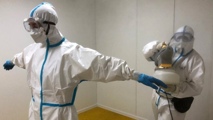 Doctors in protective gear