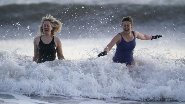 Swimmers take to the freezing North Sea at King Edward's Bay near Tynemouth on New Years Eve