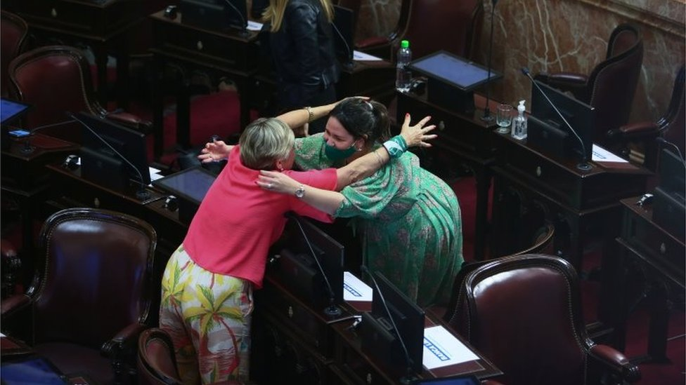 Two women hug as the senate debates an abortion bill, in Buenos Aires, Argentina, December 30, 2020