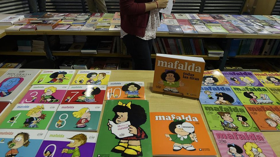 """Books of Argentine comic strip """"Mafalda"""" are displayed during the opening day of the 41th edition of the Buenos Aires International Book Fair, on April 23, 2015."""