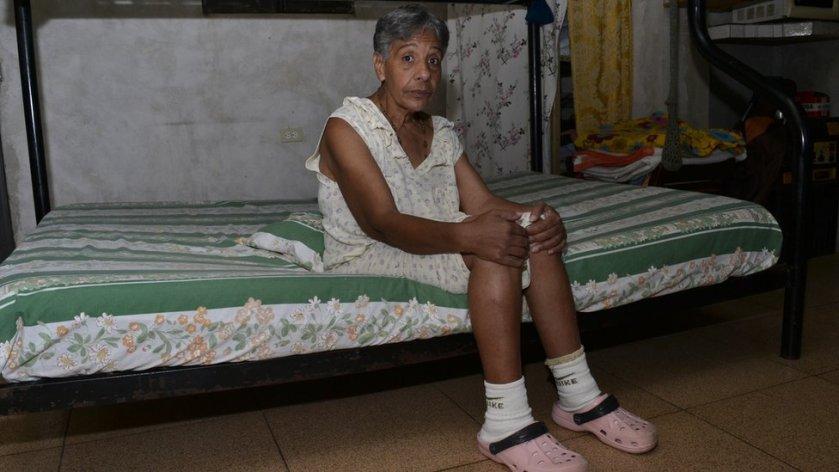 Norma Mujica sitting on a mattress