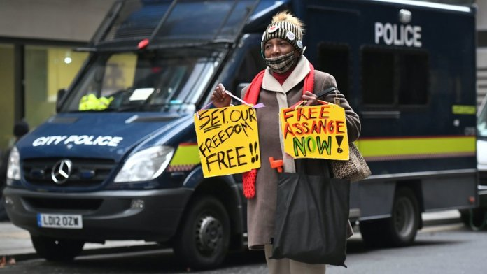 A supporter of Wikileaks founder Julian Assange outside the Old Bailey, London, ahead of a judgement in his extradition case. Assange, 49, faces an 18-count indictment, alleging a plot to hack computers and a conspiracy to obtain and disclose national defence information.