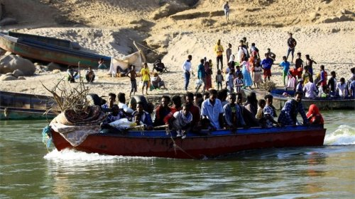 Ethiopians who fled the ongoing fighting in Tigray region, use boats to cross the Setit river on the Sudan-Ethiopia border in Hamdayet village in eastern Kassala state, Sudan November 22, 2020