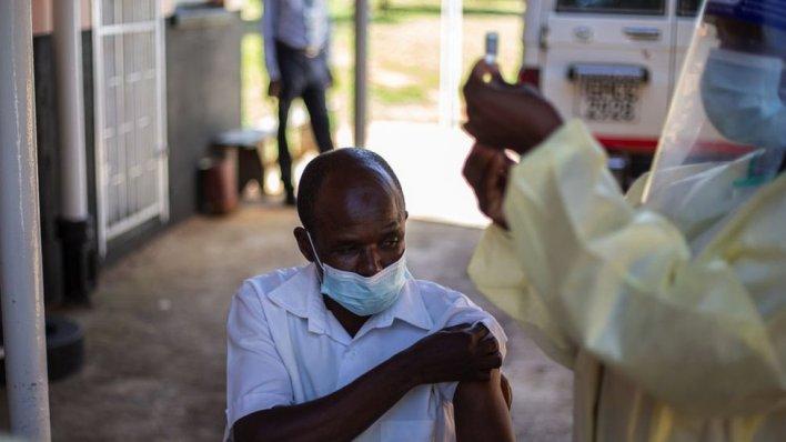A nurse prepares to get the vaccine ata village clinic near Chinhoyi, Zimbabwe, February 2021