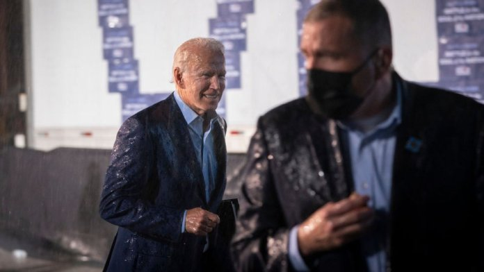Biden was caught in the rain as he left the stage in Florida