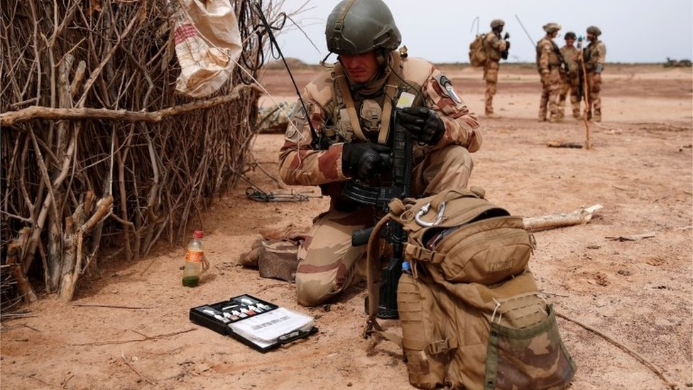 A French soldier of the 2nd Foreign Engineer Regiment uses an explosive detection kit in the Gourma region during Operation Barkhane in Ndaki, Mali, July 28, 2019