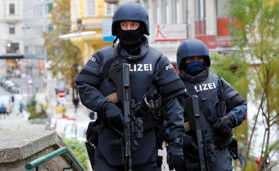 Armed police officers patrol near the site of a gun attack in Vienna, Austria, November 4