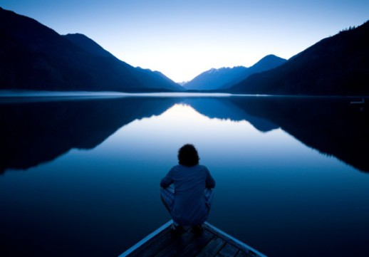 Person Sitting Quietly on the Edge of a Dock - Photo courtesy of ©iStockphoto.com/epicurean, Image #7706240