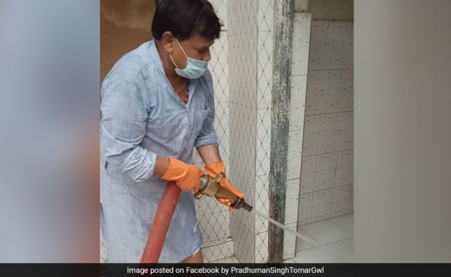Woman Complains Of Filthy Toilets To Minister. He Cleans It Himself