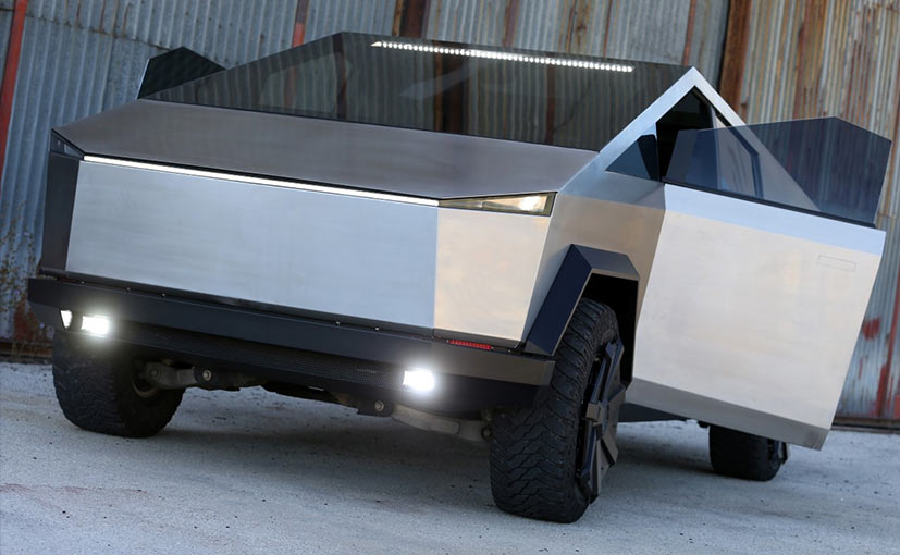 The Tesla Cybertruck replica is built on a petrol engine powered Ford Raptor F-150 pick-up truck