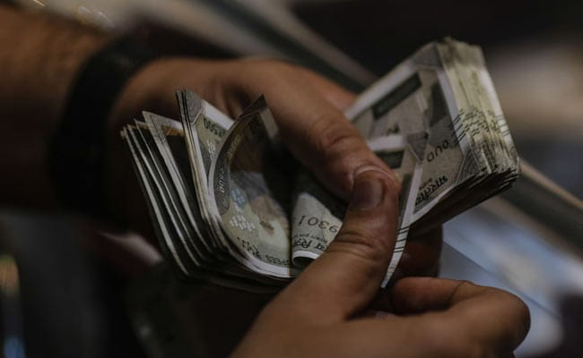 Rupee Rises By 7 Paise To 74.66 Against Dollar